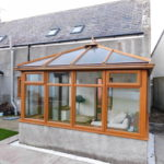 Conservatory with squishy sofa, joining the lounge or doors lead onto the enclosed garden