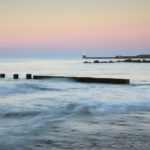Aberdeen beach with South Breakwater Lighthouse in the distance