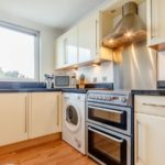 Well-equipped kitchen with Washing machine and tumble dryer