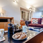 Dual aspect living and dining area with comfy seating for all